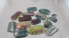 Before they are cut into pendants.